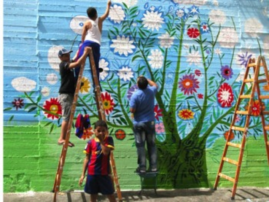 "As part of a Barefoot Artists project, residents of Balata, the West Bank's largest refugee camp, paint the ""Palestinian Tree of Life"""